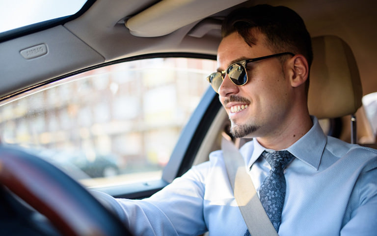 e97f937f24 Photograph of male Uber driver-partner driving in London.