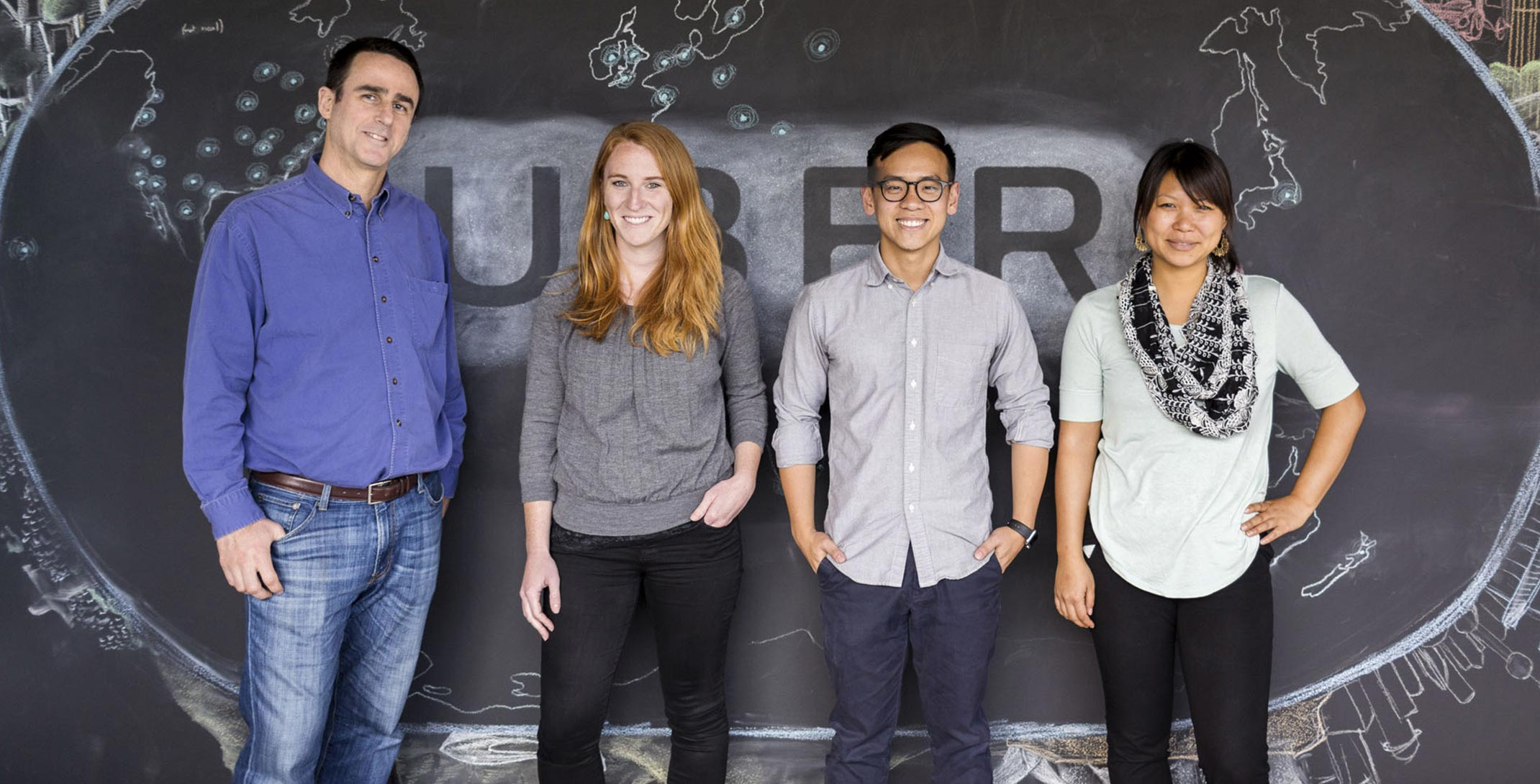find your career uber four team members stand in front of a chalkboard wall a drawing of the
